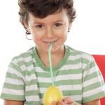 Adorable boy drinking juice of lemon — Stock Photo #9433448