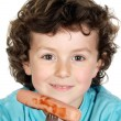 Child eating a sausage — Stock Photo #9433467