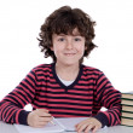 Adorable boy studying — Stock Photo #9433469