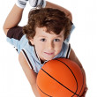Adorable child playing the basketball - Stock Photo
