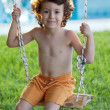 Beautiful child in swing — Stock Photo #9433506