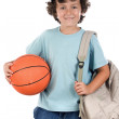 Student boy blond with a basketball — Stock Photo #9433562