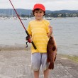 Child fisherman with red hat — Stock Photo