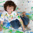 Boy playing with painting — Stock Photo #9433625