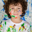Boy playing with painting - Stock Photo