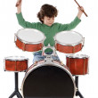 Beautiful boy playing the drums — Stock Photo