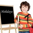 Adorable child with slate — Stock Photo #9433671