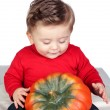 Beautiful blond baby with big pumpkin — Stock Photo #9434096