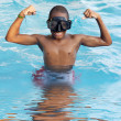 Boy in the swimming pool — Stock Photo #9434384