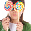 Royalty-Free Stock Photo: Girl eating two lollipops