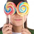 Girl eating two lollipops — Stock Photo #9435237