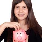 Adorable preteen girl with a piggy-bank — Stock Photo #9435308