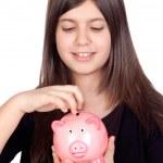 Adorable preteen girl with money box — Stock Photo #9435309