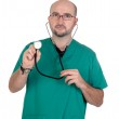 Doctor listening with a stethoscope — Stock Photo #9435547