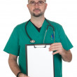 Doctor with clipboard and blank paper — Stock Photo