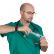 Medical green uniforms preparing a syringe — Stock Photo #9435559