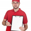 Dealer with blank clipboard and red uniform — Stock Photo