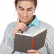 Attractive boy reading a book — Stock Photo