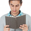 Stock Photo: Teen reading a book