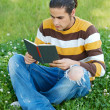 Royalty-Free Stock Photo: Casual boy reading