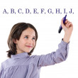 Adorable girl writing the ABC with fluorescent — Stock Photo #9436052
