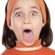 Girl sticking out her tongue - Stock Photo