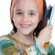 Girl brushing her hair - Stock Photo