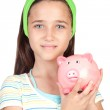 Adorable little girl with money-box — Stock Photo #9436160