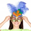 Adorable little girl with Venetian carnival mask — Stock Photo