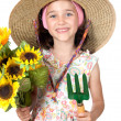 Little girl gardener with straw hat — Photo