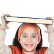 Girl holding book on head — Stock Photo #9436413