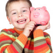 Adorable child with his piggy-bank — Stock Photo