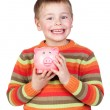 Adorable child with his piggy-bank — Stock Photo #9436532