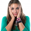 Nice girl with a look of surprise — Stock Photo #9436801