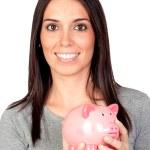 Beautiful girl with piggy-bank — Stock Photo #9437048