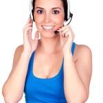 Attractive teleoperator with headphones — Stock Photo #9437200