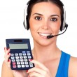 Attractive teleoperator with headphones and a calculator — Stock Photo