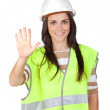 Attractive worker with reflector vest saying Stop — Stock Photo #9437364