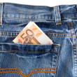 Jeans with money in the pocket — Stock Photo #9437576