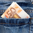 Jeans with money in the pocket — Stock Photo