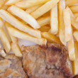 Chips and cooked pork fillets - Stock Photo