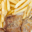Chips and cooked pork fillets — Stock Photo