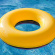 Yellow float floating in pool — Stock Photo #9437640