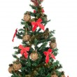 Beautiful Christmas tree with red ribbons and gold balls — Stock Photo