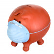 Piggy bank with protective mask - Stock Photo