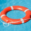 Red lifesaving float - Stock Photo