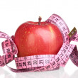 Foto Stock: Apple and measure tape