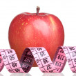 图库照片: Apple and measure tape