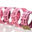 Pink tape measure with reflection on the floor — Stock Photo