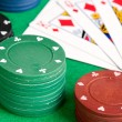 Poker cards and stacked chips — Stock Photo #9437907
